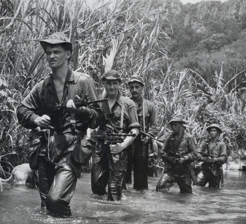 Malay and New Zealand soldiers on a jungle patrol, c1957 Note the L1A1s and Owens