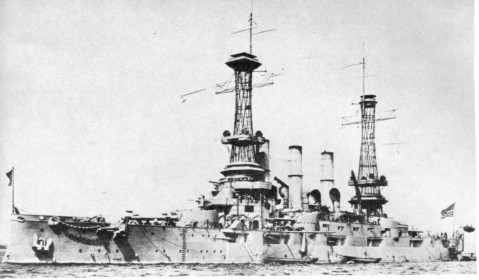 """In the Hudson River, New York, 27 December 1918. Note wartime modifications, including removal of some of the seven-inch and three-inch broadside guns and fitting of blast deflection shields on the """"cage"""" mast fire control positions. Photo courtesy of Larry Bonn. Text courtesy of USNHC # NH 2891"""