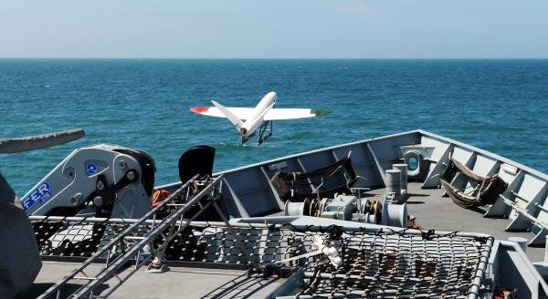 FIRST LAUNCH OF 3D PRINTED UMANED AERIAL VEHICLE - 21/7/15 Today, 21st July 2015, a 3D printed Umaned Aerial Vehicle was launched from a Royal Navy warship for the first time. HMS Mersey provided the perfect platform for the University of Southampton to test out their SULSA unmanned aerial vehicle (UAV). Weighing 3kg and measuring 1.5m the airframe was created on a 3D printer using laser sintered nylon and catapulted off HMS Mersey into the Wyke Regis Training Facility in Weymouth, before landing on Chesil Beach. The flight, which covered roughly 500 metres, lasted less than few minutes but demonstrated the potential use of small lightweight UAVs, which can be easily launched at sea, in a maritime environment. The aircraft carried a small video camera to record its flight and Southampton researchers monitored the flight from their UAV control van with its on-board video-cameras. Known as Project Triangle the capability demonstration was led by Southampton researchers, making use of the coastal patrol and fisheries protection ship. With a wingspan of nearly 1.5 metres, the UAV being trialled has a cruise speed of 50kts (58mph) but can fly almost silently. The aircraft is printed in four major parts and can be assembled without the use of any tools. MOD Crown Copyright