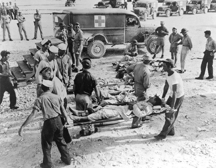 Survivors of the sinking of the Indianapolis are taken to a hospital on Guam after their rescue in August, 1945.