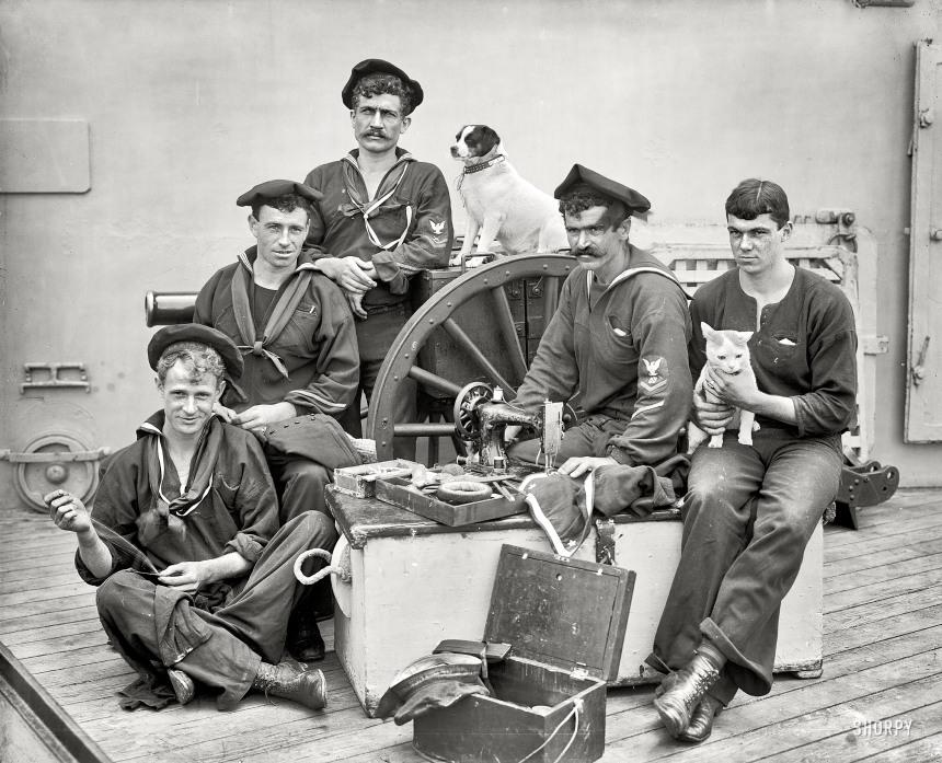 U.S.S. New York circa 1896. Ship's tailor The dog is Nick.