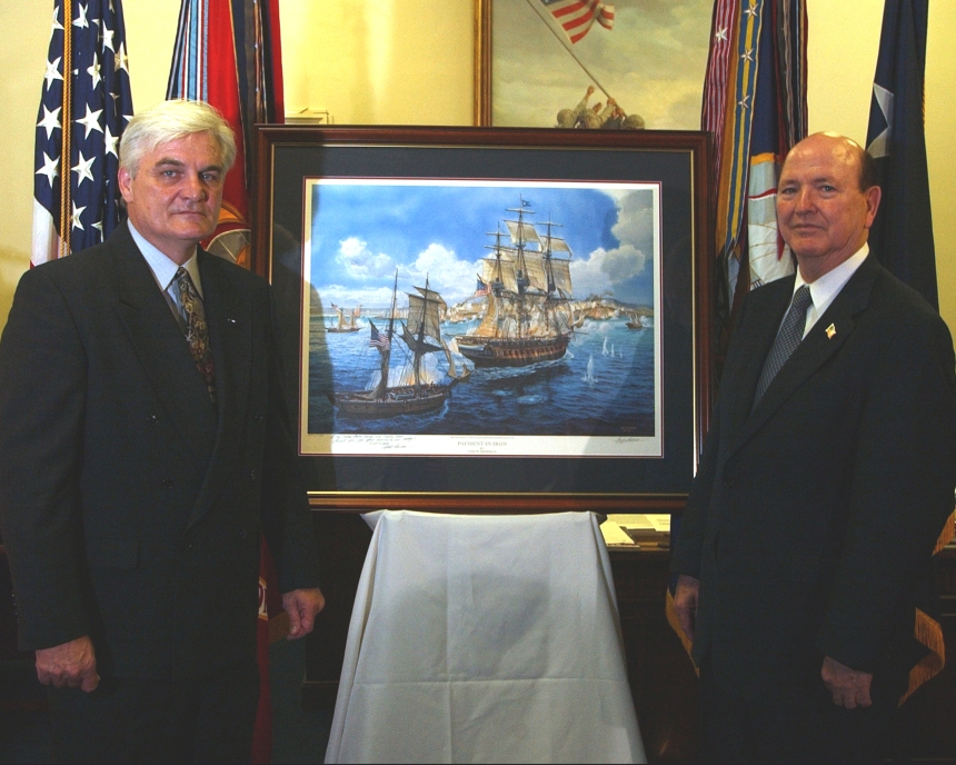 """(16 June 2003) Award-winning artist Tom W. Freeman presents his painting """"Payment in Iron"""" to the Honorable Hansford T. Johnson, Acting Secretary of the Navy (SECNAV). The artwork will hang in the main entrance to the Acting SECNAV's office. U.S. Navy photo by Journalist 1st Class Craig P. Strawser."""