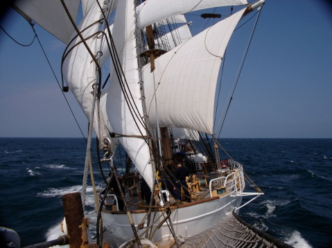 (June 26, 2005) ONBOARD THE USCGC EAGLE - A view from the bowsprit onboard the Eagle during a cadet summer training patrol.The U.S. Coast Guard Cutter EAGLE, designated 'America's Tallship' is a three masted, square- rigged sailing vessel. She is normally homeported in New London, Connecticut, and sails each summer for months at a time, visiting ports around the U.S. and abroad. EAGLE has a long history in service as a training vessel. After she was built and commissioned in 1936, she served as training vessel for cadets in the German Navy. In the 1940s, EAGLE began service as a training platform for Coast Guard Academy officer candidates. Today, nearly all future officers have the opportunity to sail onboard the EAGLE, learning skills such as leadership, teamwork, seamanship, and navigation. (Coast Guard photo by Ensign Ryan Beck)
