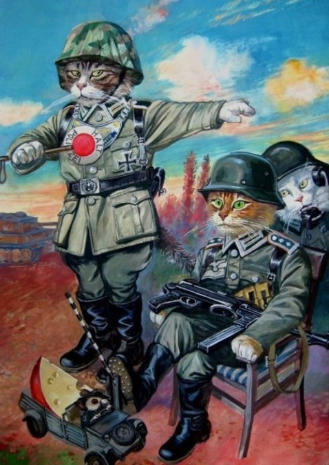Russian cats in the German army-- note the Schmisser and the dog collar gorget on the German Feldgendarmerie