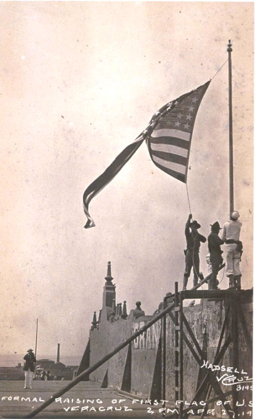 Formal raising of first flag of U.S. Veracruz 2 P.M. April 27, 1914 by sailors and Marines of the Utah and Florida
