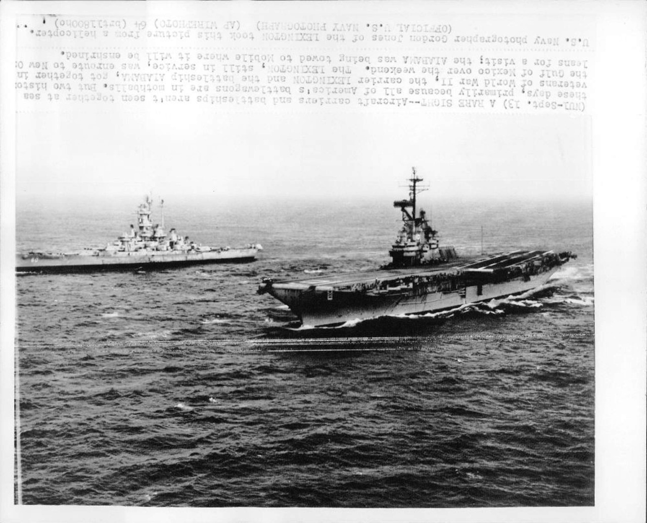 """""""Sept. 13[1964] A RARE SIGHT—Aircraft carriers and battleships aren't seen together at sea these days, primarily because all of America's battlewagons are in mothballs. But two historic veterans of WW II, the carrier Lexington and the battleship Alabama got together in the Gulf of Mexico over the weekend. The Lexington, still in service, was en route to New Orleans for a visit; the Alabama was being towed to Mobile where it will be enshrined."""""""