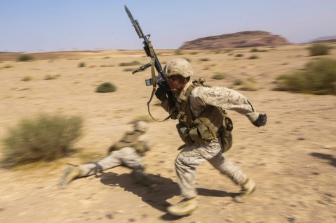 SOUTHWEST ASIA (Sept. 17, 2015) U.S. Marine Lance Cpl. Jonathan Ripoyla moves to his next firing position during a bi-lateral training exercise. Ripoyla is a rifleman with India Company, Battalion Landing Team 3rd Battalion, 1st Marine Regiment, 15th Marine Expeditionary Unit. The 15th MEU, embarked aboard the ships of the Essex Amphibious Ready Group, is a forward-deployed, flexible sea-based Marine air-ground task force capable of engaging with regional partners and maintaining regional security. (U.S. Marine Corps photo by Sgt. Jamean Berry/Released)