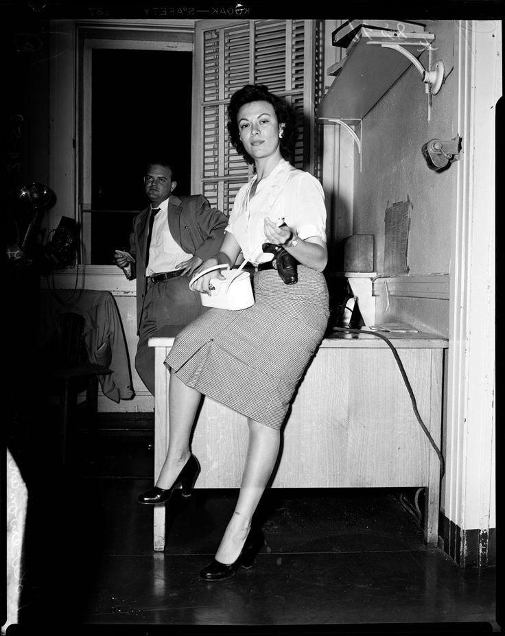 Policewoman Florence Coberly preparing for undercover work luring rapists in Los Angeles. Note her 38 carried in a crossdraw holster.