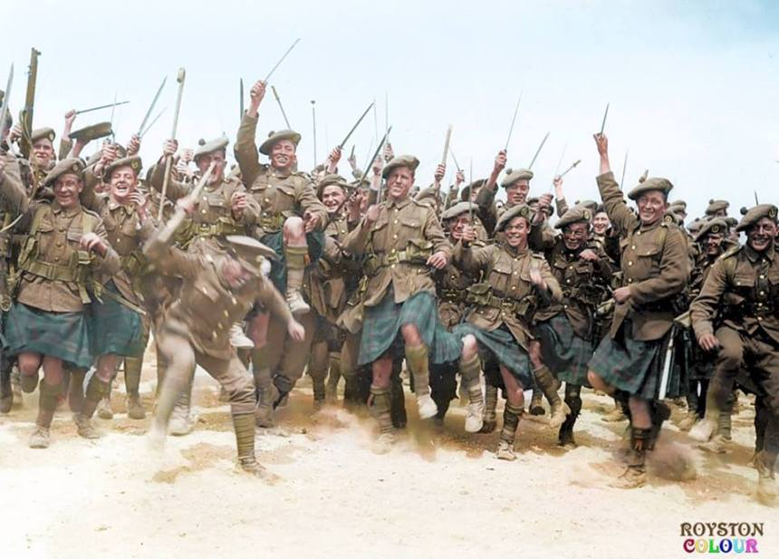 Rare and fascinating image of a South African fighting regiment in World War 1. Here South Africans from the 4th Regiment 'South African Scottish' perform a traditional 'African Tribal War Dance' with drawn bayonets and dancing in their distinctive 'Murray of Atholl' tartan kilts. The image was taken at the 'Bull Ring' in Etaples, France prior to the troops final deployment to trench warfare 18 June 1918. (Colourised by Royston Leonard from the UK) https://www.facebook.com/pages/Colourized-pictures-of-the-world-wars-and-other-periods-in-time/182158581977012