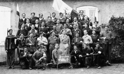 The SOE went to new places and made friends like this mustached Brit operative seen in the center of this group of French resistance