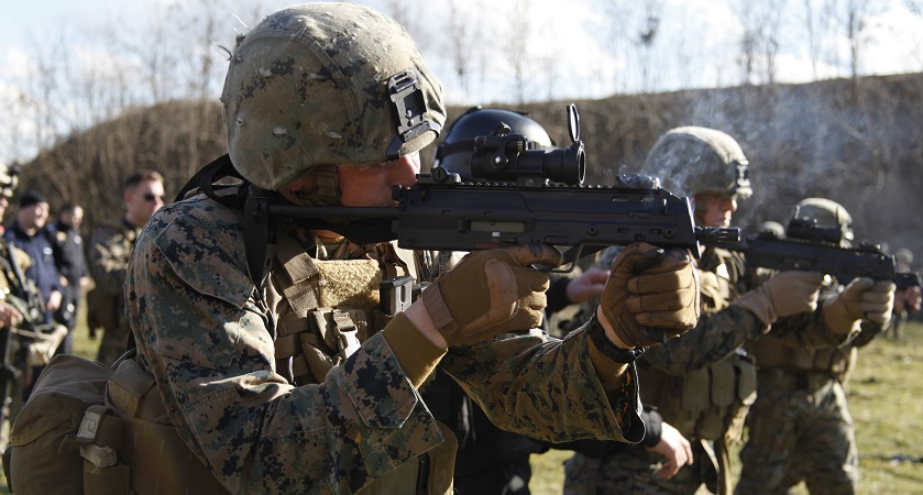 U.S. Marines from Alpha Fleet Anti-terrorism Security Team Company Europe (FASTEUR), Naval Station Rota, shoot MP-7 machine guns at the Romanian intelligence service shooting range in Bucharest, Romania, Feb. 26, 2015. FASTEUR Marines conducted small arms marksmanship training with host nation forces during an embassy engagement to familiarize both forces on weapons normally used during security operations. (U.S. Marine Corps photo by Sgt. Esdras Ruano/Released)