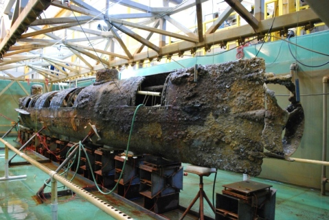 The uncleaned stern of the historic Confederate submarine, CSS Hunley, is seen in a photo provided by the group Friends of the Hunley. The sub has recently been cleaned of the 1,200 pounds of undersea concretions that had accumulated over the 136 years the sunken sub rested on the bottom outside Charleston harbor. Courtesy of Friends of the Hunley via The Washington Post