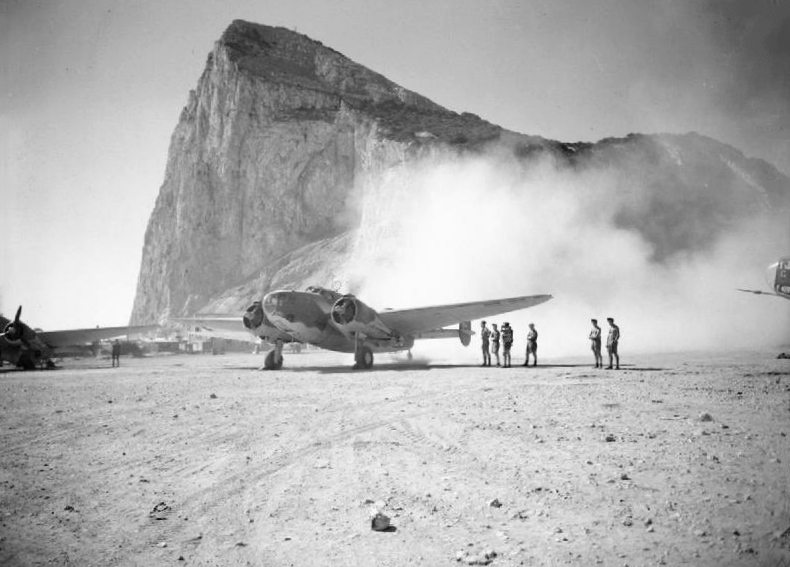 Lockheed Hudson of No. 233 Squadron RAF preparing for take-off in August 1942, with the Rock of Gibraltar in the background. Taken by Lt. G.W. Dallison, War Office official photographer - This is photograph GM 1405 from the collections of the Imperial War Museums; captioned A Royal Air Force Lockheed Hudson III of No. 233 Squadron RAF leaves its dispersal at Gibraltar for a reconnaissance sortie.