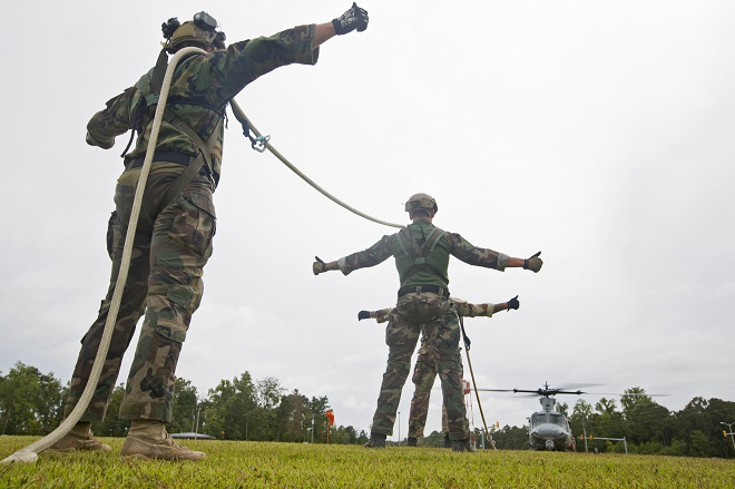 U.S. Marines with Marine Raider Regiment, prepare to be lifted during special patrol insertion/extraction training from a UH-1Y Huey assigned to Marine Light Attack Helicopter Squadron (HMLA) 167, at Stone Bay, Camp Lejeune, N.C., Sept. 23, 2015. HMLA-167 Marines flew from Marine Corps Air Station New River to assist MARSOC with the training. (U.S. Marine Corps photo by Lance Cpl. Austin A. Lewis/Released)