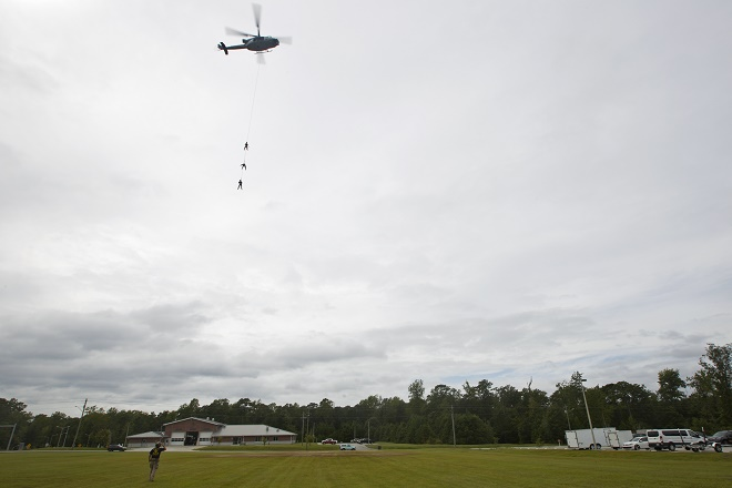 A UH-1Y Huey assigned to Marine Light Attack Helicopter Squadron (HMLA) 167, lifts Marines with Marine Raider Regiment, during special patrol insertion/extraction training at Stone Bay, Camp Lejeune, N.C., Sept. 23, 2015. HMLA-167 Marines flew from Marine Corps Air Station New River to assist MARSOC with the training. (U.S. Marine Corps photo by Lance Cpl. Austin A. Lewis/Released)
