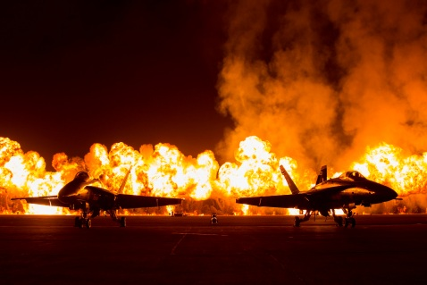 Two FA-18 Jets are displayed in front of the Wall of Fire during the Marine Corps Community Services sponsored 2015 Air Show aboard Marine Corps Air Station Miramar, San Diego, Calif., Oct. 3, 2015. The air show showcases civilian performances and the aerial prowess of the armed forces and their appreciation of the civilian community's support and dedication to the troops. (U.S. Marine Corps Combat Camera photo by  Cpl. Trever A. Statz/Released)