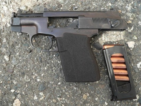 PSS internally suppressed pistol with action open and magazine of ready rounds.