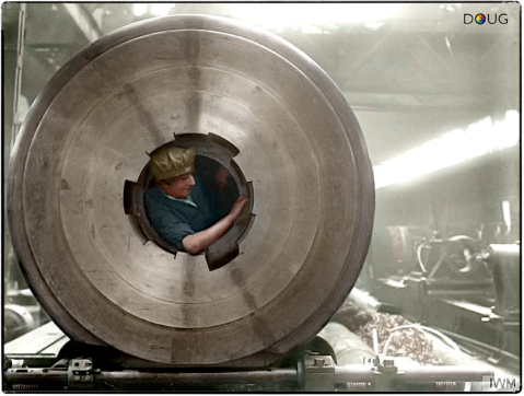 From the same shoot: A female worker cleans the rifling of a 15-inch gun after being lifted inside the barrel in the Coventry Ordnance Works, Warwickshire during the First World War. (Source -IWM Q 30135) Colorized by Doug