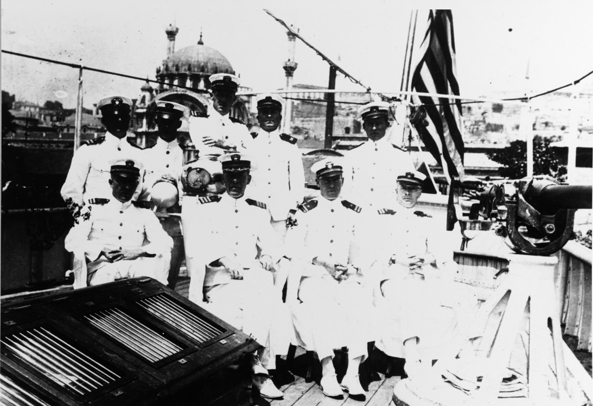 View taken at Constantinople, Turkey, in 1919 of ship's officers. Front row (L-R): Lieutenant Samuel R. Deets, USN; Commander Richard P. McCullough, USS; Lieutenant Leonard Doughty, USN. Back row: Lieutenant George P. Shields (MC), USN; Paymaster Clarence Jackson, USN; Lieutenant William O. Baldwin, USN; Lieutenant Gale A. Poindexter, USN. Description: Courtesy of LCDR Leonard Doughty, 1929 Catalog #: NH 50276