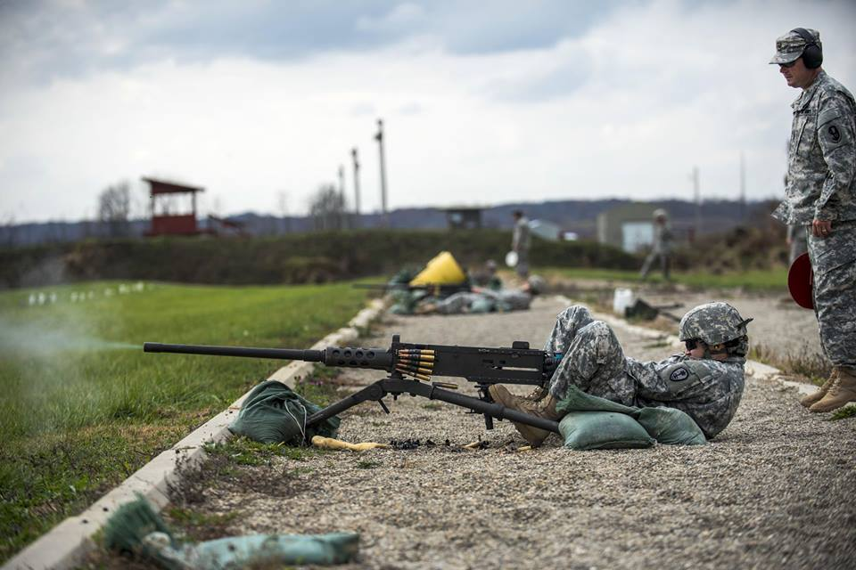 U.S. Army Cpl. Brittany Montana fires an M2 Browning .50-caliber machine gun on Camp Atterbury. Montana is a Reservist assigned to the 354th Military Police Company. U.S. Army photo by Master Sgt. Michel Sauret.
