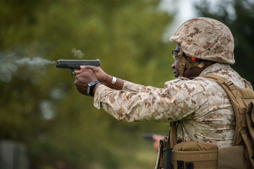 U.S. Marine Corps Sgt. Maj. Ansil Lewis, Weapons Training Battalion Sgt. Maj., fires a Glock 17 pistol the Royal Marine Operational Shooting Competition (RMOSC), hosted by the British Royal Marines at Altrar Training Camp, Hightown, England, Sept. 9-16, 2015. The purpose of the RMOSC is to evaluate the marksmanship skill, and physical and operational abilities of American, British, French, and Dutch Marines in combat related shooting matches by utilizing realistic structures, fast-moving targets, and movement to contact drills. (U.S. Marine Corps photo by Cpl. Timothy Turner/Released)
