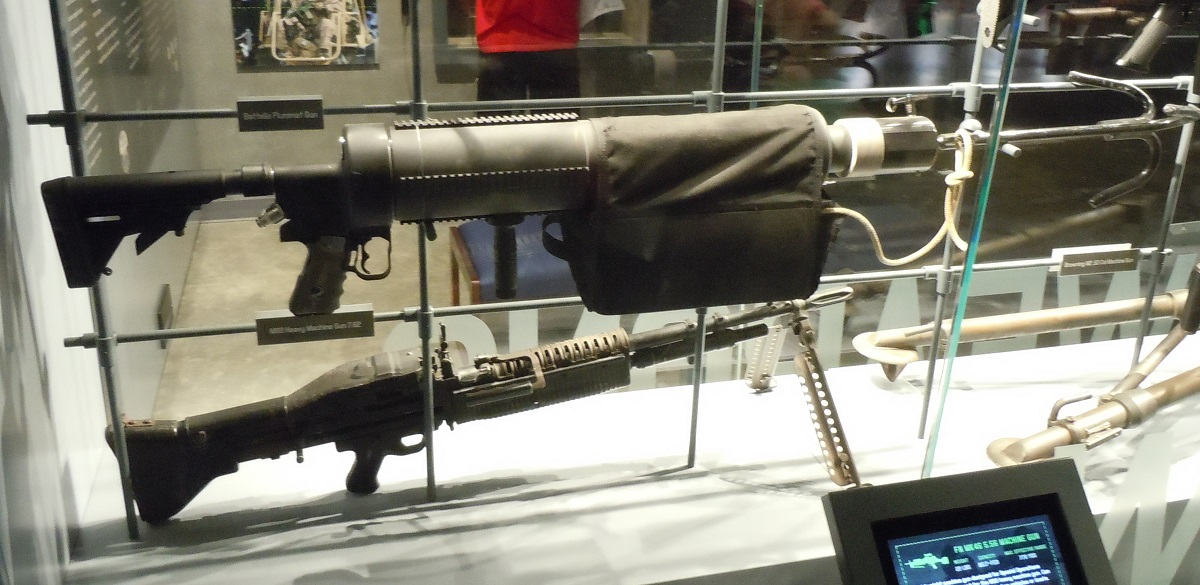Meet the 25 pound Battelle Plummet Gun, and yes, it is as big as the M60 shown next to it for scale. Image via Chris Eger