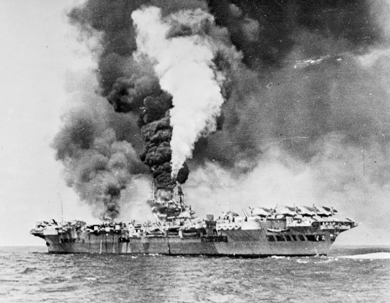 Famous image of Formidable on fire after the kamikaze hit on 4 May, photograph A 29717 from the collections of the Imperial War Museum