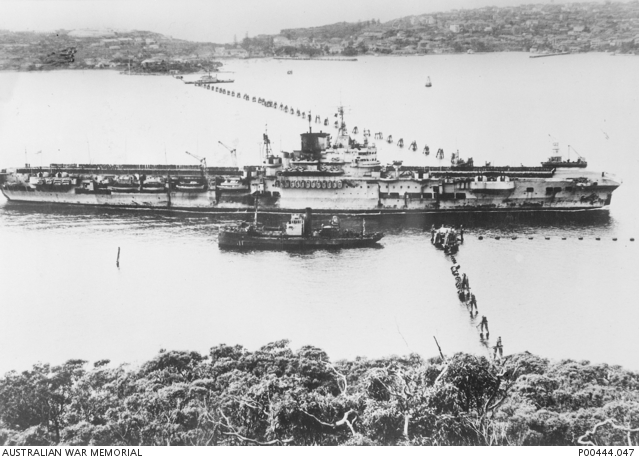 HMS FORMIDABLE passing through the Sydney Harbour anti-submarine boom net in 1945
