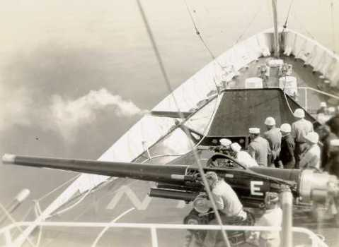 Ingham's crew undergoing battle practice, in this case firing both of her main 5-inch 50-caliber main batteries.