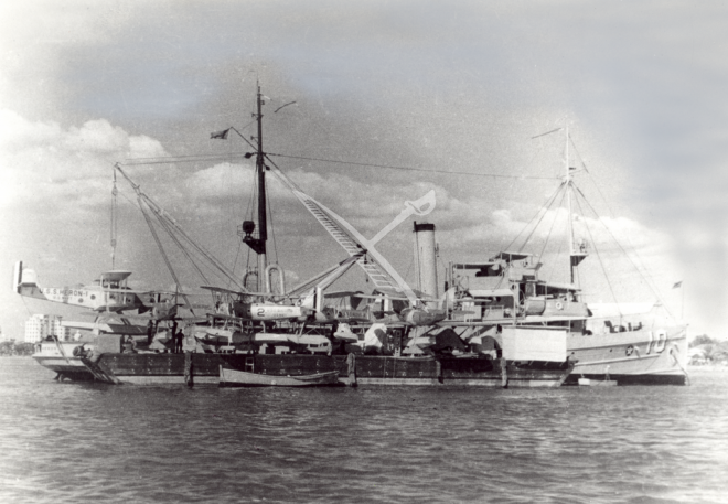 U.S. Navy Small Seaplane Tender USS Heron (AVP-2); no date. Note the floatplane service barge alongside. Image via navsource http://www.navsource.org/archives/11/02010.htm