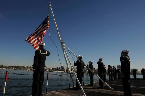 SAN DIEGO (Nov. 23, 2015) Aviation Ordnanceman Airman Noe Mendoza, from Harlingen, Texas, raises the American flag aboard the aircraft carrier USS Theodore Roosevelt (CVN 71). Theodore Roosevelt arrived at its new homeport of San Diego after completing an eight-month around-the-world deployment. (U.S. Navy photo by Mass Communication Specialist 3rd Class Anthony N. Hilkowski/Released)
