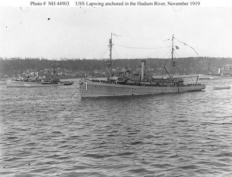 Review of the Atlantic Fleet Minesweeping Squadron, November 1919. USS Lapwing (AM-1) and other ships of the squadron anchored in the Hudson River, off New York City, while being reviewed by Secretary of the Navy Josephus Daniels on 24 November 1919, following their return to the United States after taking part in clearing the North Sea mine barrage. The other ships visible are: USS Lark (Minesweeper No. 21), with USS SC-208 alongside (at left); and USS Swan (Minesweeper No. 34) with USS SC-356 alongside (at right). Heron was there, but is not seen on the photo. U.S. Navy photo NH 44903