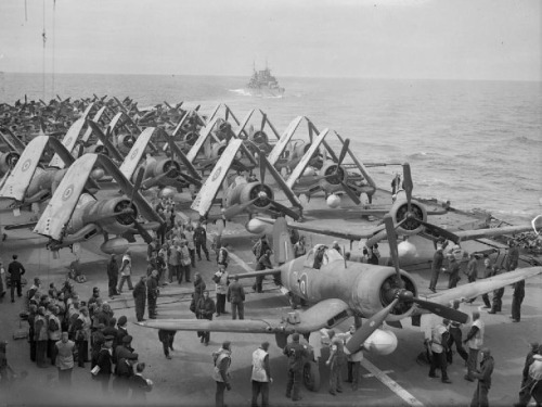 Vought Corsair fighters and Fairey Barracuda bombers on the deck of aircraft carrier HMS Formidable during an operation off Norway, July 1944