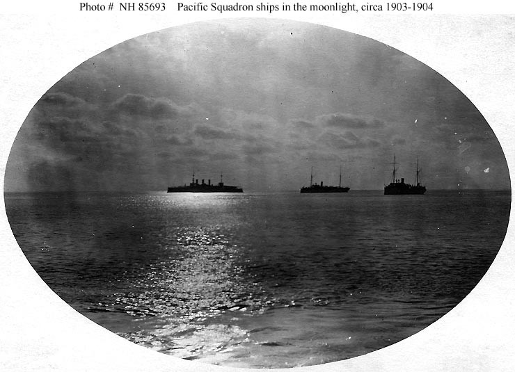 Ships of the squadron in the moonlight, during a Latin American cruise, circa 1903-1904. USS New York (Armored Cruiser # 2) is in the left center. The other two ships, listed in no particular order, are USS Concord (Gunboat # 3) and USS Bennington (Gunboat # 4). Donation of William L. Graham, 1977. U.S. Naval History and Heritage Command Photograph. Catalog #: NH 85693