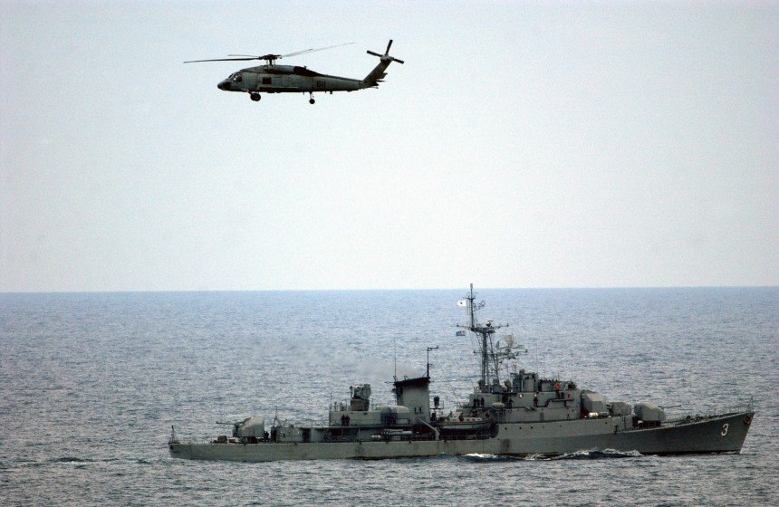 040616-N-8148A-047 South Pacific Ocean (June 16, 2004) Ð An SH-60F Seahawk assigned to the ÒIndiansÓ of Helicopter Anti-Submarine Squadron Six (HS-6) flies past the Uruguayan Naval Frigate, Montevideo. HS-6 is embarked on USS Ronald Reagan (CVN 76), which is currently circumnavigating South America to her new homeport of San Diego, Calif. U.S. Navy photo by PhotographerÕs Mate 3rd Class Kitt Amaritnant (RELEASED)