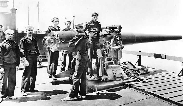 "Stern 6"" (15.2 cm) gun on S.S. Mongolia on 19 May 1917, shown for reference. The Yorktown class had six of these including some in both open mounts such as this and barbettes. U.S. Naval Historical Center Photograph # NH 41710."