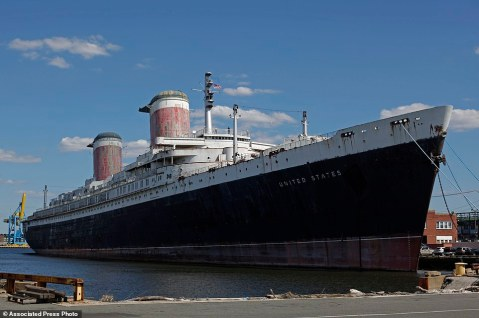 FILE - This July 1, 2010, file photo shows the SS United States, a luxury ocean liner removed from service in 1969 and moored for nearly two decades in Philadelphia. The SS United States, a historic and record-breaking ocean liner that once hosted royalty and presidents, has escaped the scrap heap and will undergo a rebirth, supporters announced Thursday, Jan. 28, 2016. (AP Photo/Matt Rourke, File)