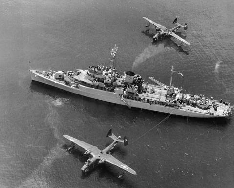 The United States Navy Barnegat-class seaplane tender USS Timbalier (AVP-54) with two Martin PBM-3D Mariner flying boats from the Pelicans of Patrol Squadron 45 in the late 1948. Timbaler´s quadruple 40mm gun mount on the fantail was added in around 1948. National Archives #80-G-483681