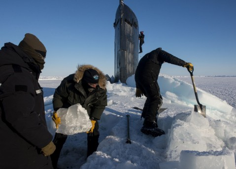 160314-N-QA919-151 ARCTIC CIRCLE (March 14, 2016) Sailors and civilians, assigned to Arctic Submarine Lab, clear the ice from the hatch of USS Hampton (SSN 767) during Ice Exercise (ICEX) 2016. ICEX 2016 is a five-week exercise designed to research, test, and evaluate operational capabilities in the region. ICEX 2016 allows the U.S. Navy to assess operational readiness in the Arctic, increase experience in the region, advance understanding of the Arctic environment, and develop partnerships and collaborative efforts. (U.S. Navy photo by Mass Communication Specialist 2nd Class Tyler Thompson)