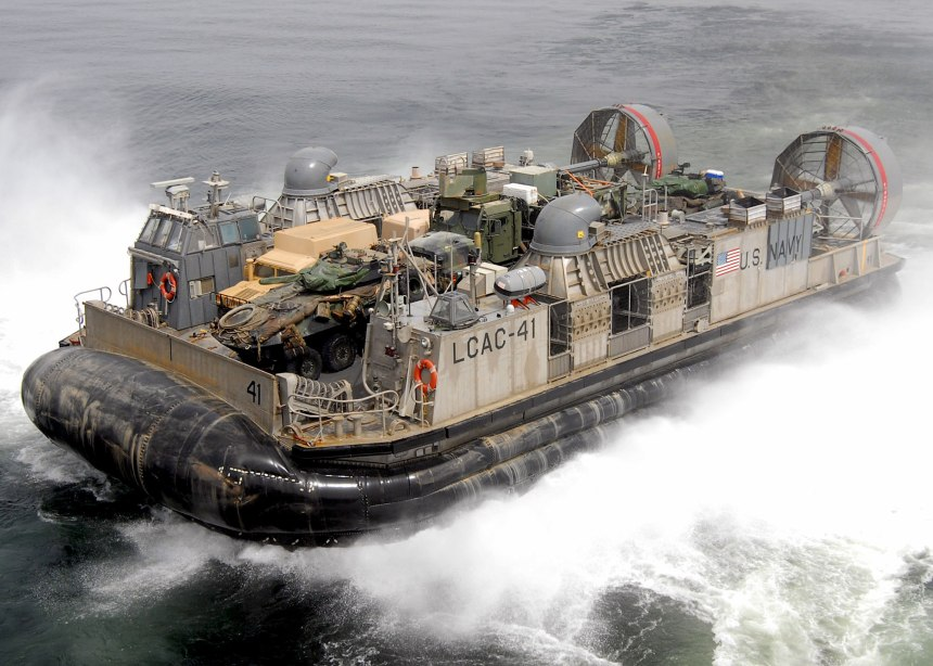 A landing craft air cushion leaves the well deck aboard the USS Iwo Jima in the Persian Gulf, Sept. 21, 2006