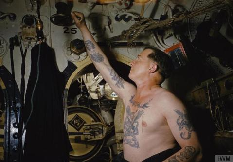 actor operating a high pressure valve on board HMS TRIBUNE during the making of the film 'Close Quarters