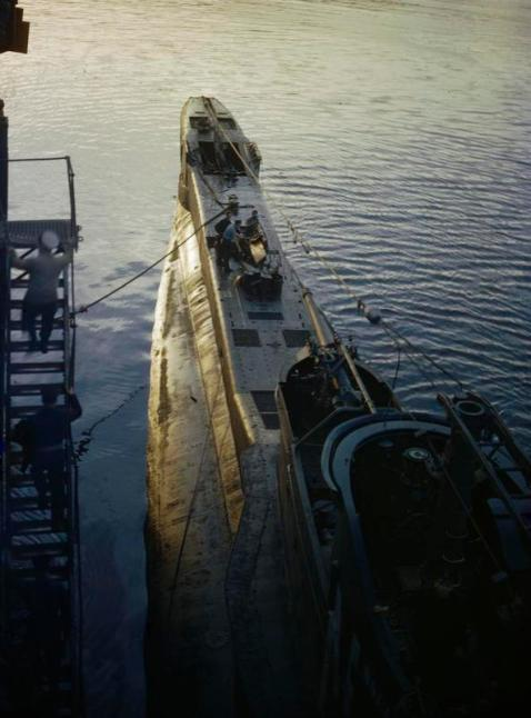 HMS TRIBUNE lying alongside the submarine depot ship HMS FORTH at Holy Loch, Scotland at dawn