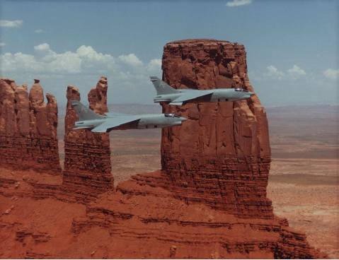pair of VFP-206 RF-8G Crusaders flies over Monument Valley