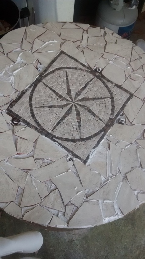 Ceramic and stone mosaic added to the top spool (don't worry, this is in the rough before grout was added)