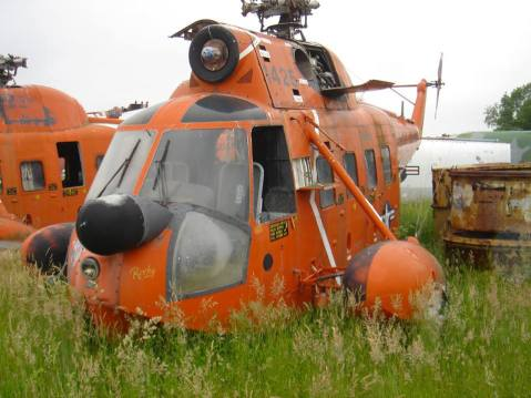 "#1426 as put out to pasture. She had seen better days. Note the 1980s ""SAR Orange"" paint scheme"