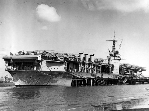 The USS Ranger (CV-4) is moored at North Island, California with aircraft on her deck. 03/14/1938. Naval Aviation Museum Accession Number 1996.488.013.010.