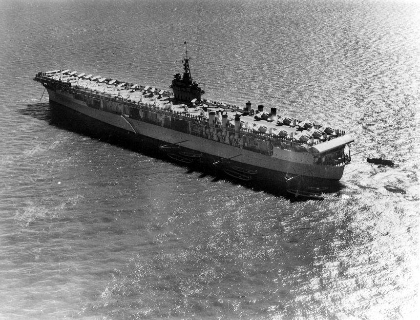 The USS Ranger (CV-4) lies at anchor with aircraft neatly aligned on her deck. 1940. Naval Aviation Museum Accession Number 1996.488.013.013.