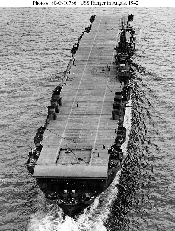 Underway in Hampton Roads, Virginia, 18 August 1942. Note partially lowered after elevator and flight deck identification letters R N G R still visible just ahead of the ramp. Also note that her stacks have been lowered. Official U.S. Navy Photograph, now in the collections of the National Archives. NHC Catalog #: 80-G-10786