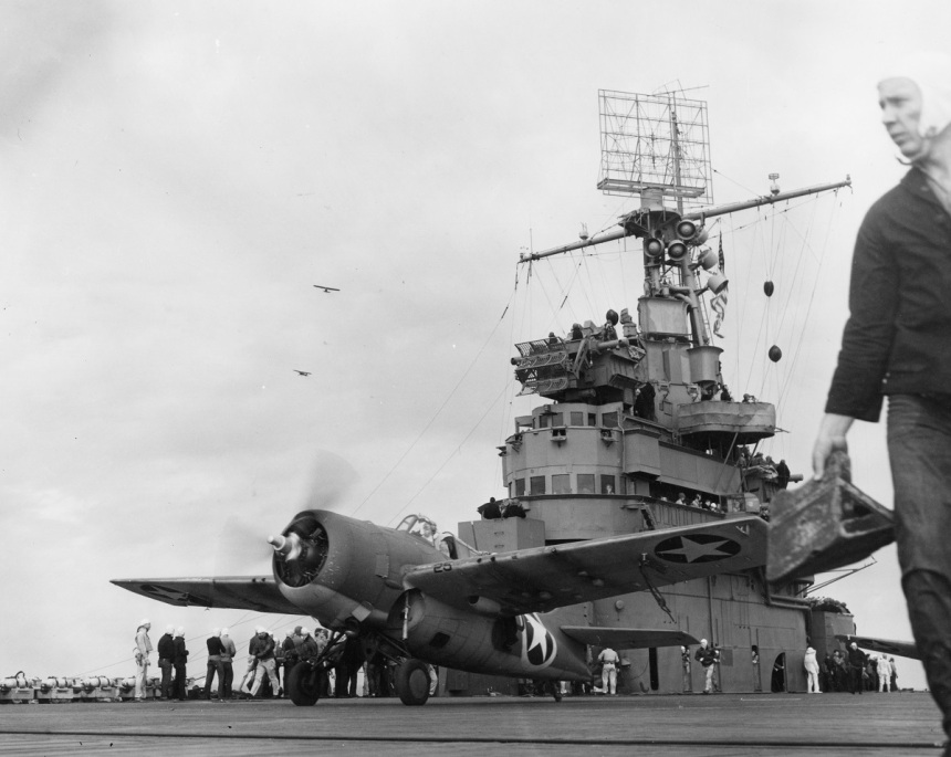 A Grumman F4F-4 Wildcat fighter taking off from USS Ranger (CV-4) to attack targets ashore during the invasion of Morocco, circa 8 November 1942. Note: Army observation planes in the left middle distance; Loudspeakers and distinctive CXAM radar antenna on Ranger's mast. Her group at the time consisted of 72 operational planes (1 CRAG, 17 VS-41, 26 VF-9, and 28 VF-41) Official U.S. Navy Photograph, now in the collections of the National Archives. NHC Catalog #: 80-G-30244