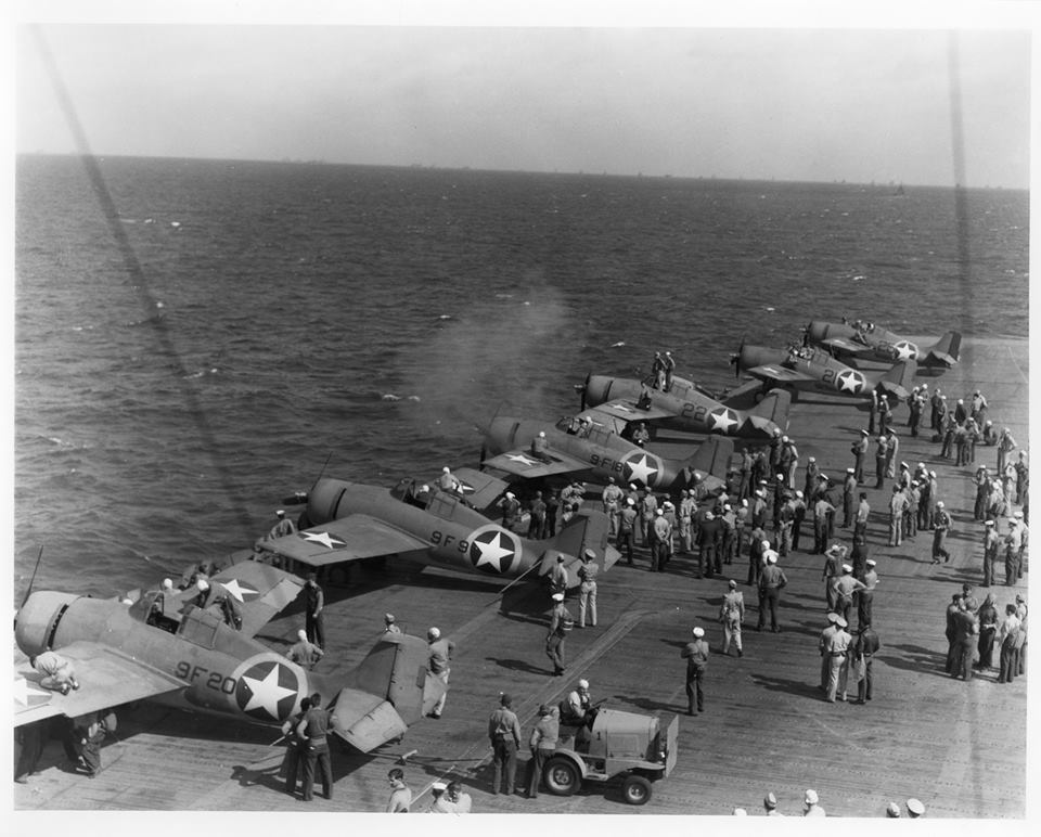 North Africa Operation, November 1942 - testing machine guns of Grumman F4F-4 Wildcat fighters aboard USS Ranger (CV 4), while en route from the U.S. to North African waters, circa early November 1942. Note the special markings used during this operation, with a yellow ring painted around the national insignia on aircraft fuselages. Official U.S. Navy Photograph, now in the collections of the National Archives. Catalog #: 80-G-30362